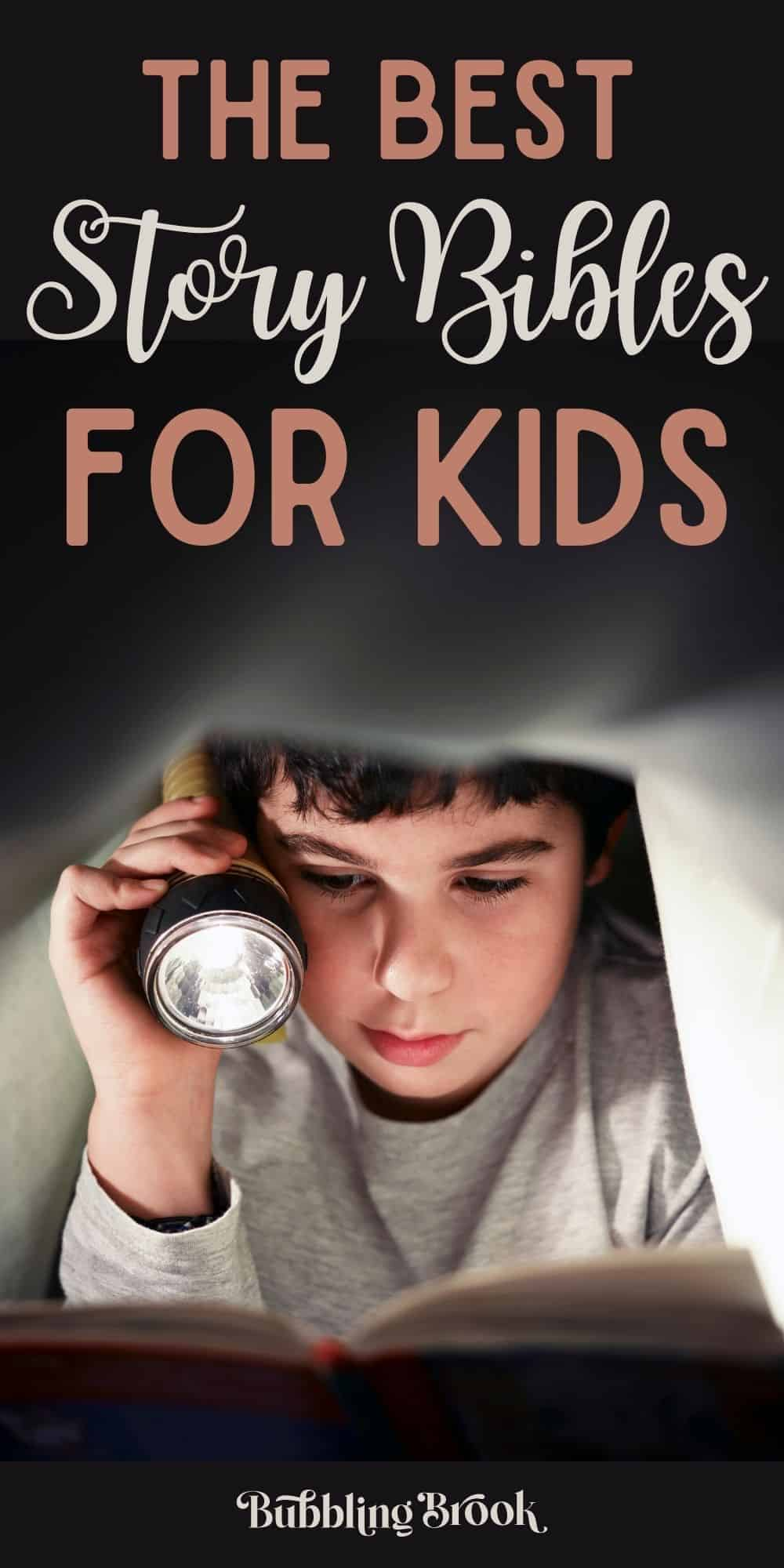 Boys reading best kids bibles under covers with flashlight