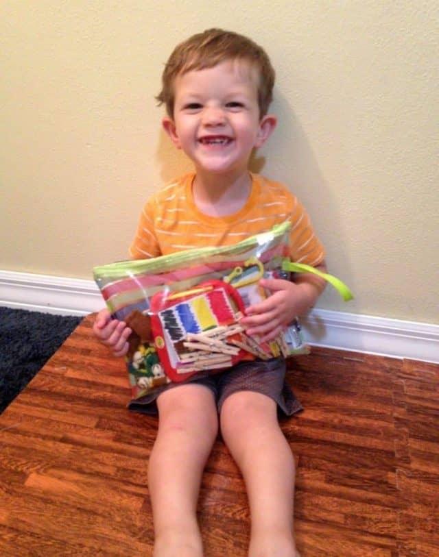 Boy with church busy bag