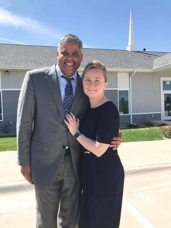 My husband and I in front of the new church a couple of years ago