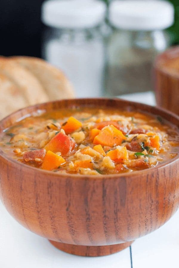 This Carrot and Lentil Soup recipe is packed full of flavor! Crispy bacon and a splash of white wine compliments the lentils and carrots, creating a hearty, filling soup that's an easy family favorite.
