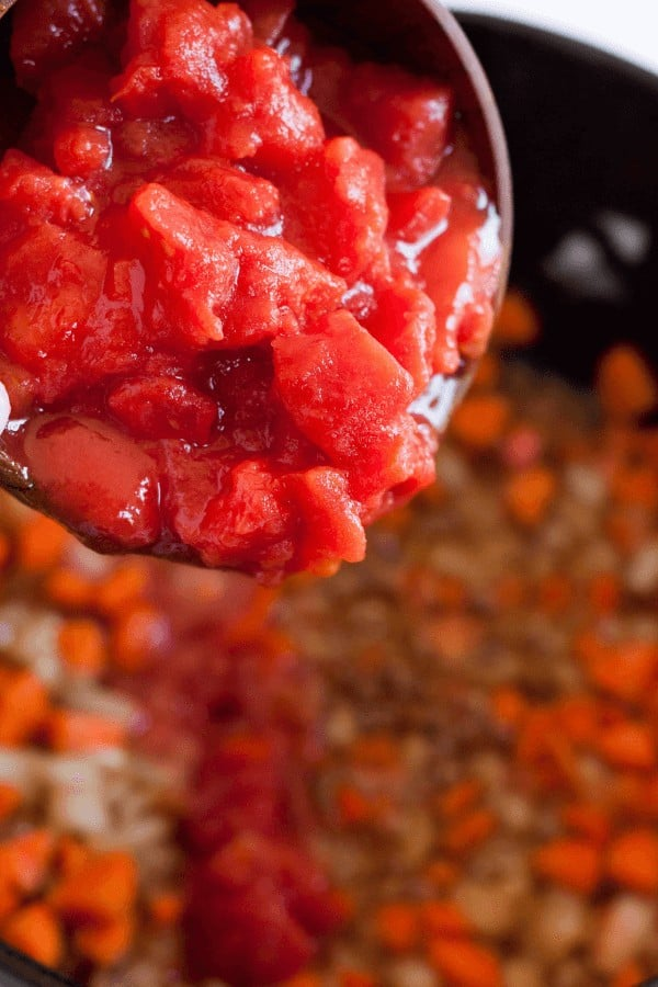 Adding tomatoes to lentil soup