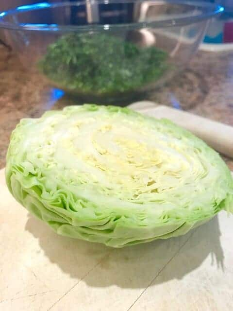 Wedge of cabbage on a cutting board