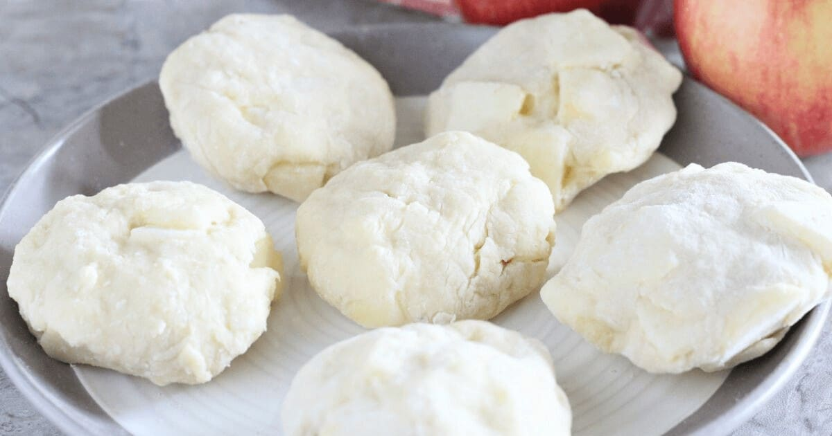 Donut batter shaped into discs