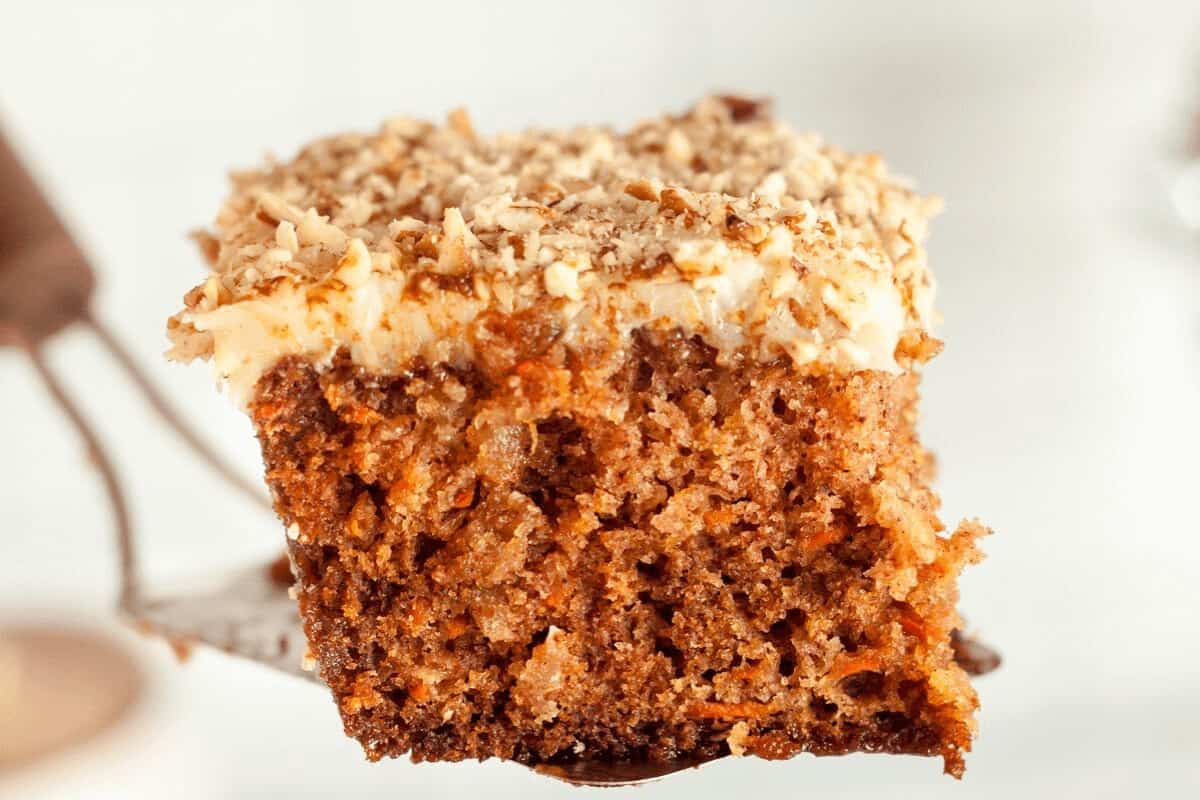 Slice of carrot cake, up close on a fork