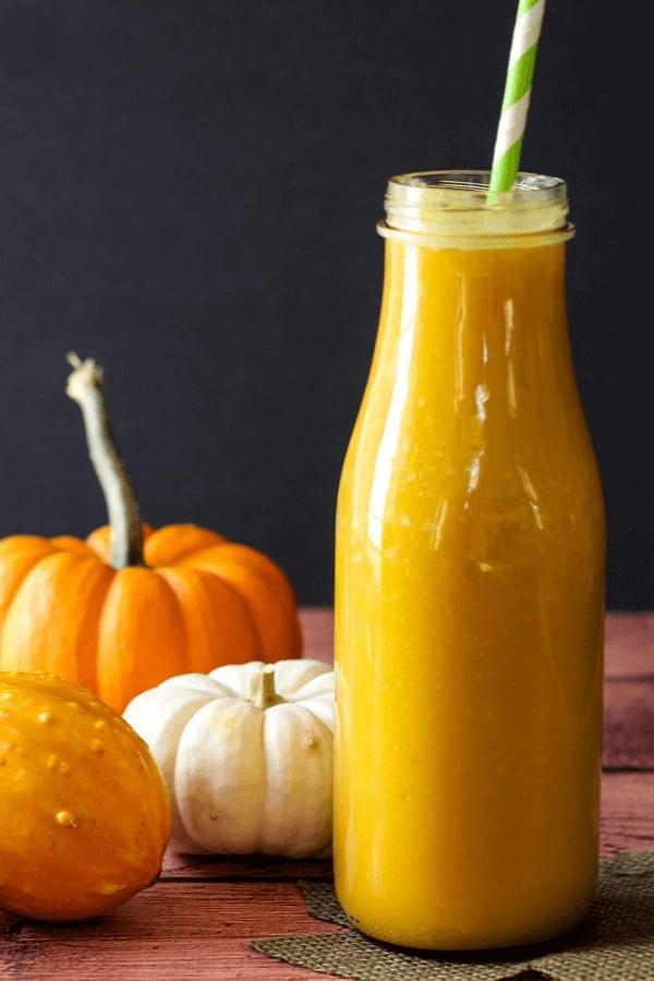 Orange Mango Smoothie in a glass jar