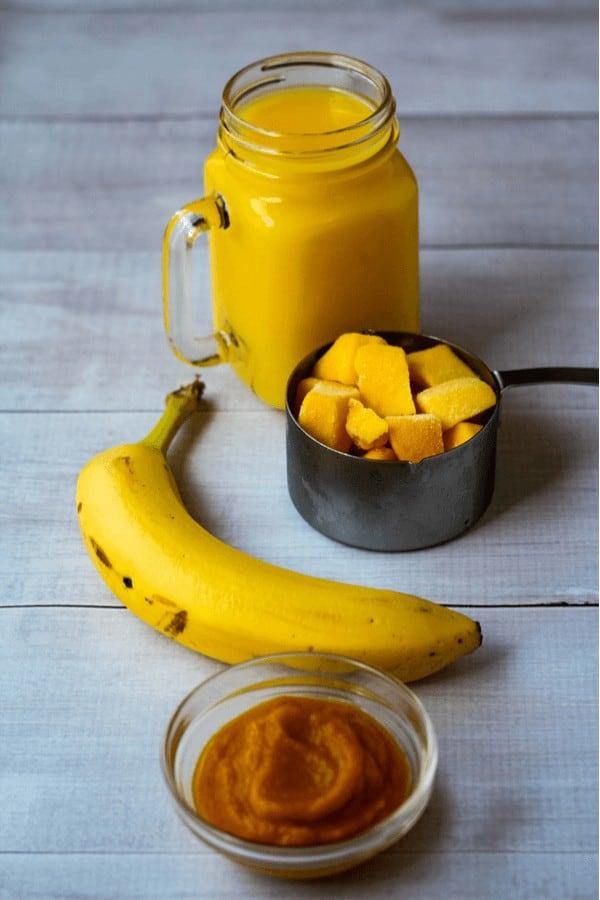 Orange Mango Smoothie ingredients laid on a table
