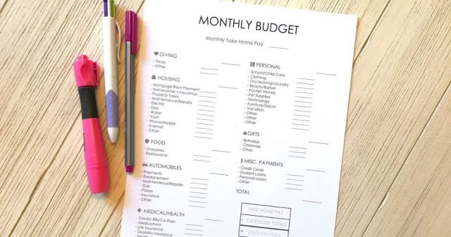 free monthly budget printable on a desk with pens