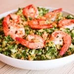 Shrimp kale salad in a low bowl