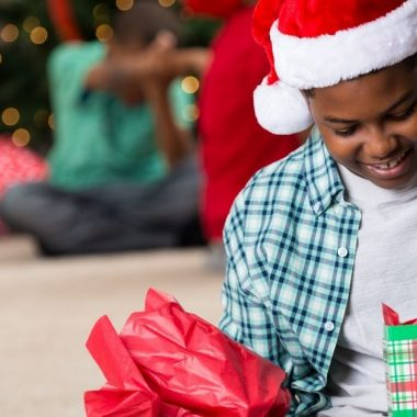 11 year old boy opening his Christmas gift