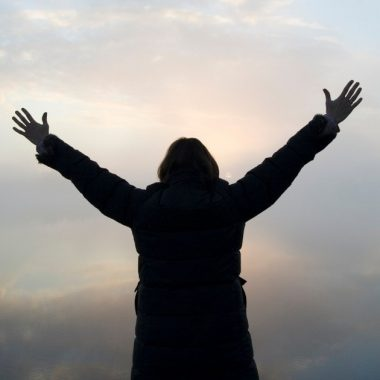 Photo of woman lifting hands to worship