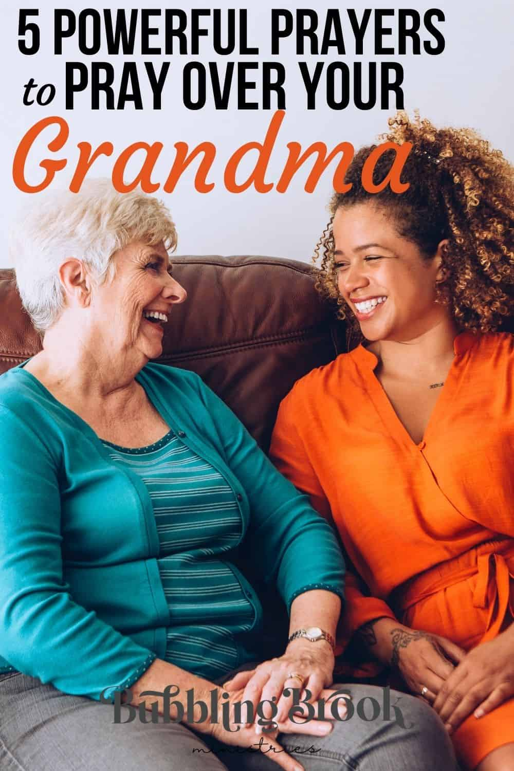 Grandma and granddaughter sitting on couch together
